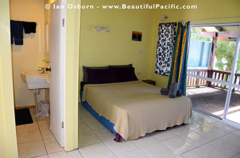 inside the Beachfront Studio Unit at Tianas showing sleeping area and bathroom entrance